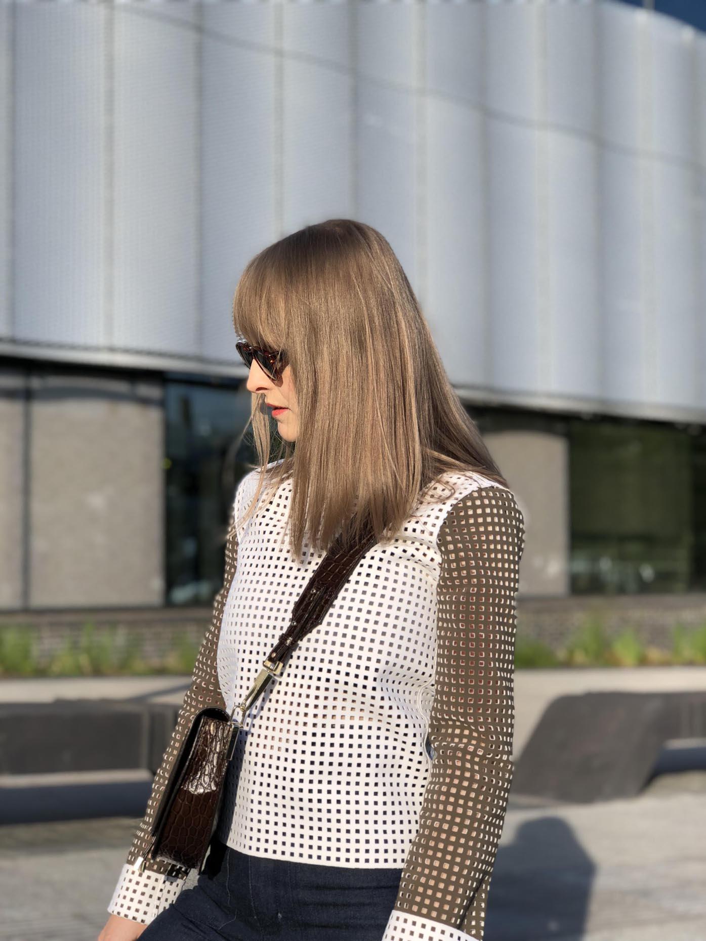 jw anderson, saddle bag zofia chylak, polaroid sunglasses by fashion art media